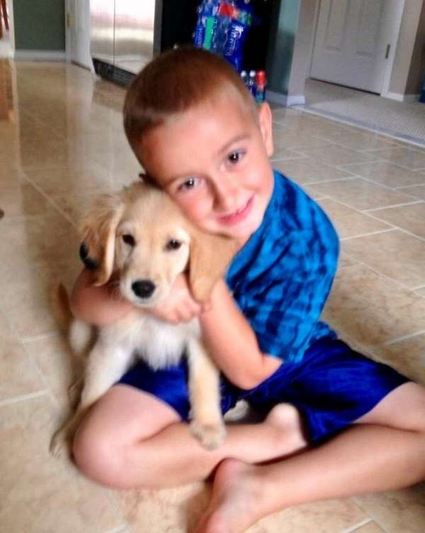 Kidsday reporter Brayden Elenterio hugs his dog, Brody.