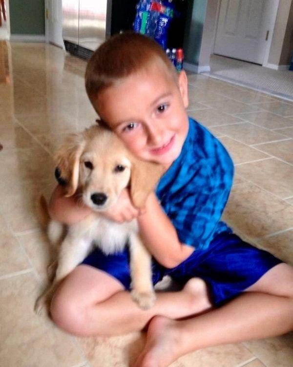 Kidsday reporter Brayden Elenterio hugs his dog, Brody.