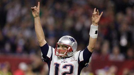 New England Patriots' Tom Brady raises his arms