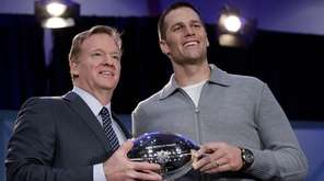 New England Patriots quarterback Tom Brady walks off