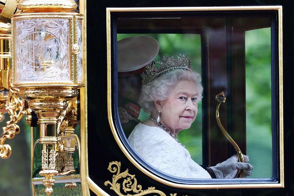 Queen Elizabeth II returning to Buckingham Palace by