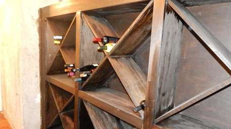 A wine cellar sits in a corner of