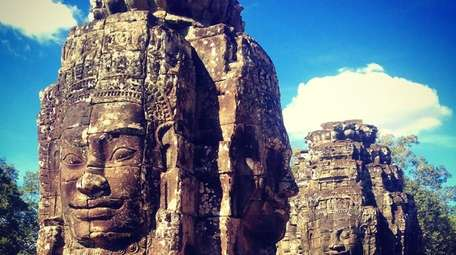 Bayon is a temple of Angkor that many