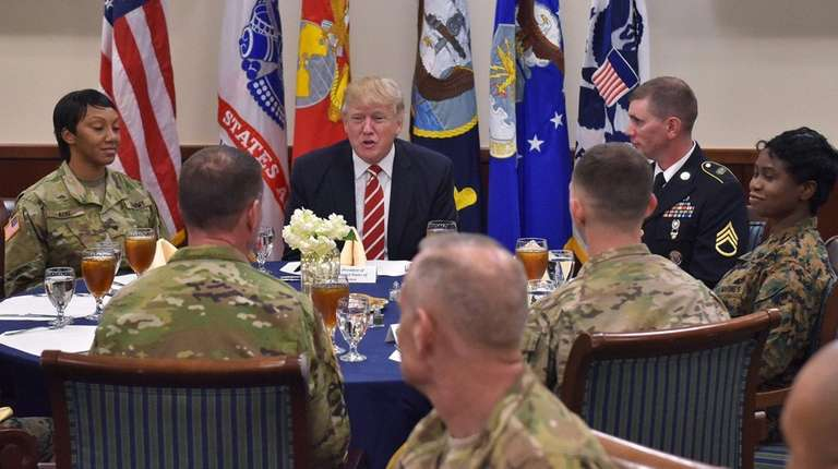 President Donald Trump meets with troops during a