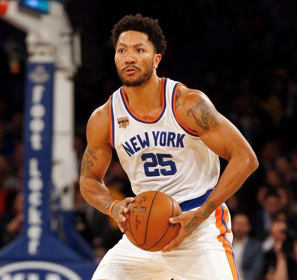Knicks' Derrick Rose looks to pass the ball
