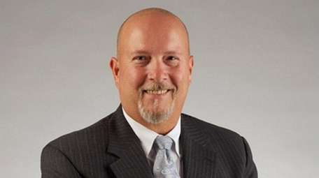 Suffolk Federal Credit Union announced Ralph D. Spencer