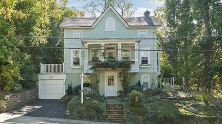 This circa-1940 Colonial in Northport Village has a