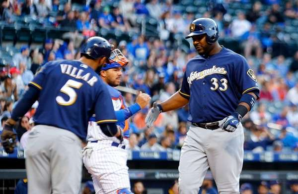 Chris Carter of the Milwaukee Brewers celebrates his first-inning,