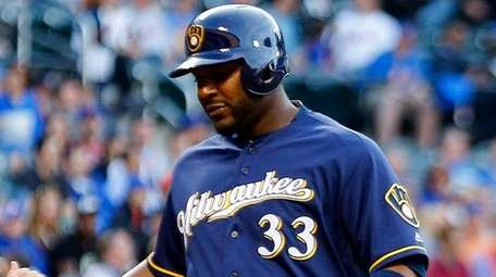 Chris Carterof the Milwaukee Brewers celebrates his first-inning,