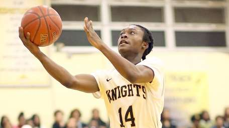 Uniondale's Alfredo Lyde with the basket during the