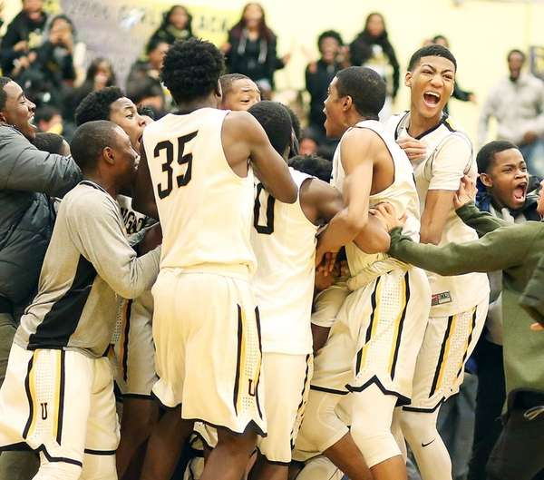 Team and fans on court after Uniondale's Danny