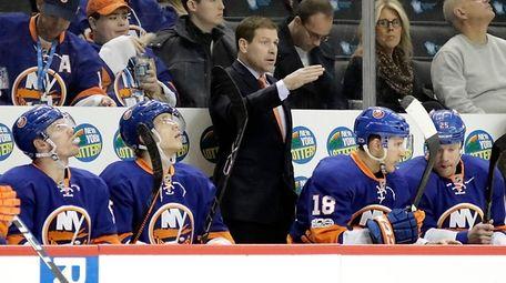 Islanders head coach Doug Weight looks on from