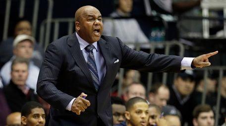 Georgetown head coach John Thompson III yells to