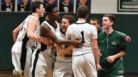 Harborfields players celebrate their 49-47 win against Amityville