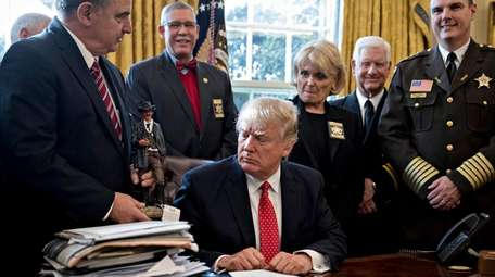 President Donald Trump meets with county sheriffs in
