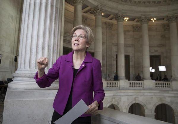 Sen. Elizabeth Warren (D-Mass.) reacts to being rebuked