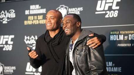 Anderson Silva, left, and Derek Brunson pose at