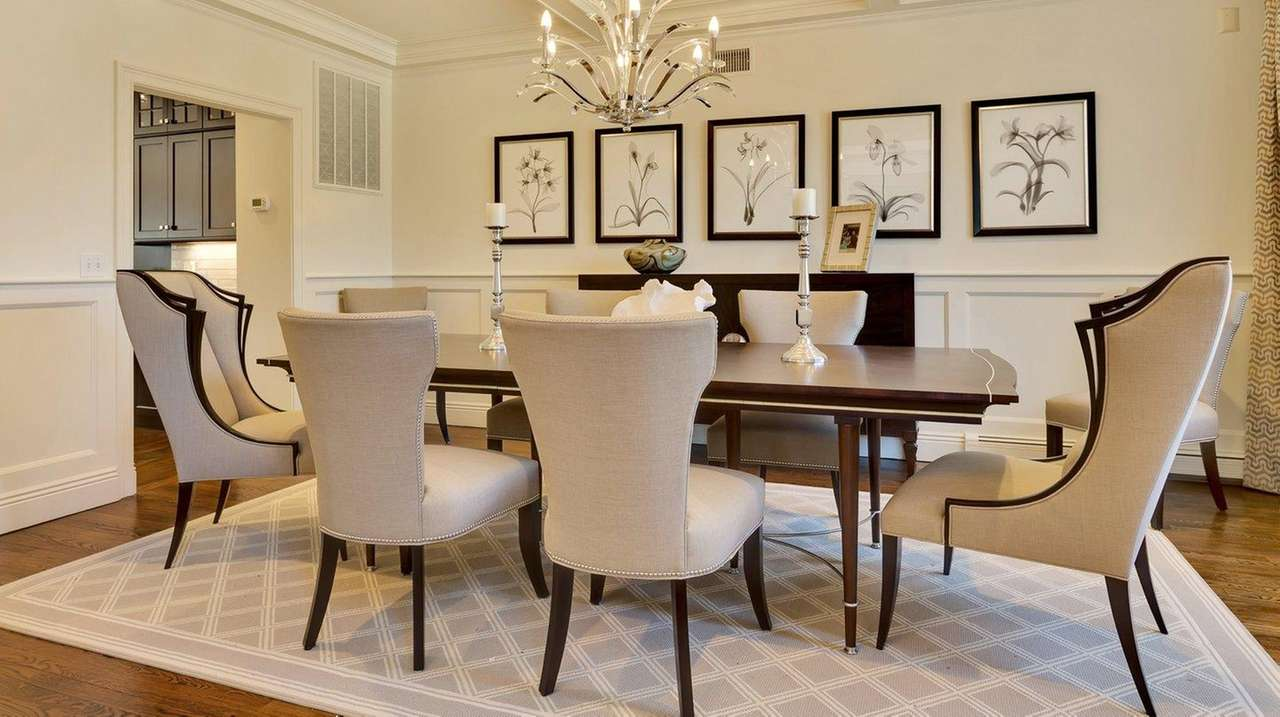 Statement chairs highlight this Woodbury dining room designed