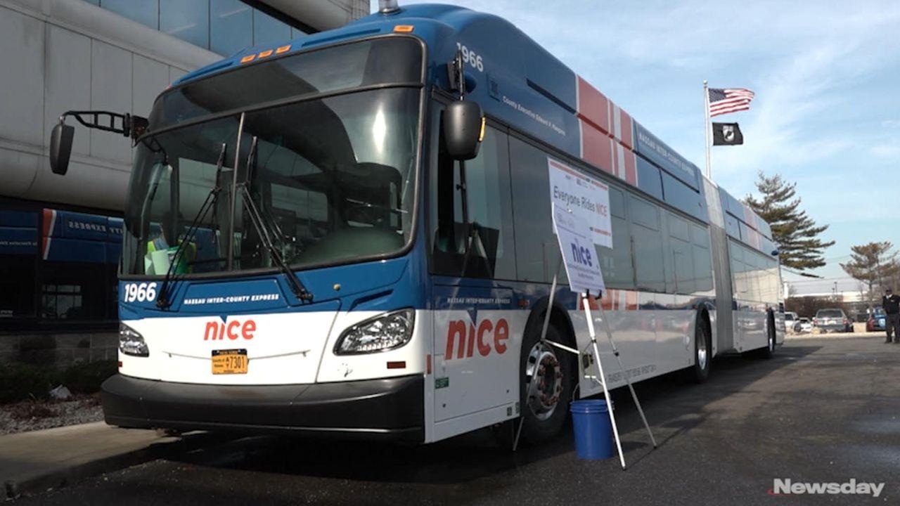 Nassau Inter-County Express CEO Michael Setzer and officials