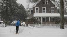 Larry Hillel, of East Hampton, shovels snow in