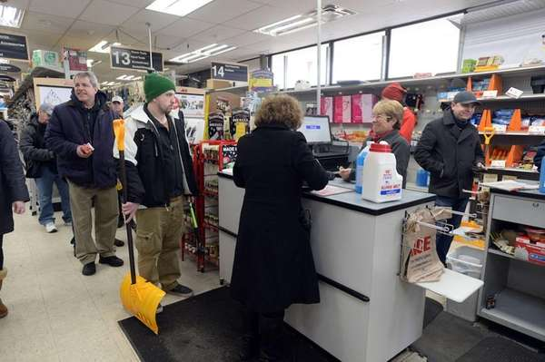 Shoppers stock up on ice melt and shovels