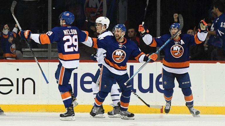 New York Islanders center Brock Nelson and teammates