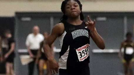Farmingdale's Njaure Ewa finished first in the girls
