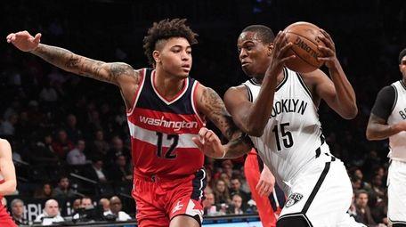 Brooklyn Nets guard Isaiah Whitehead drives against Washington