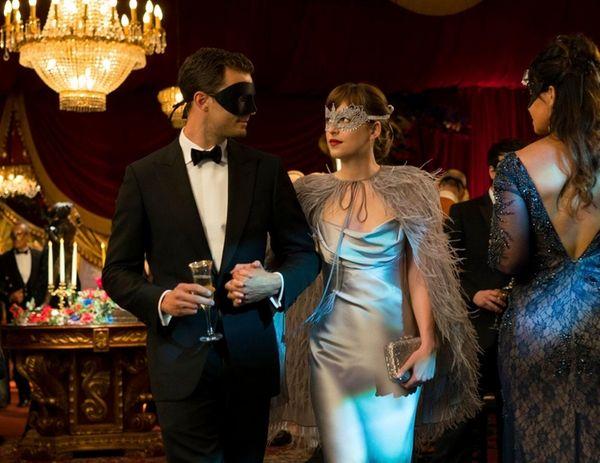 Jamie Dornan as Christian Grey and Dakota Johnson