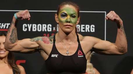 Cris Cyborg Justinoposes during the weigh-in for her