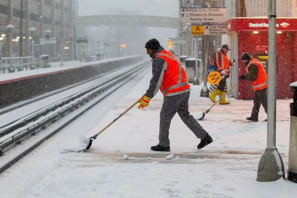 LIRR crews work on clearing the platform at