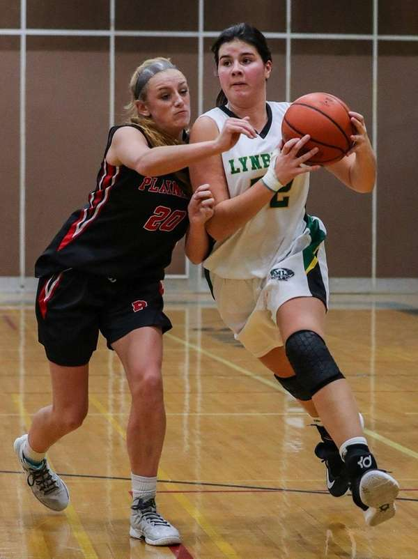 Lynbrook's Kerrin Montgomery, right, is closing in