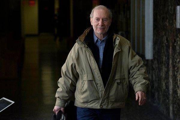 Stanley Patz walks inside state Supreme Court in