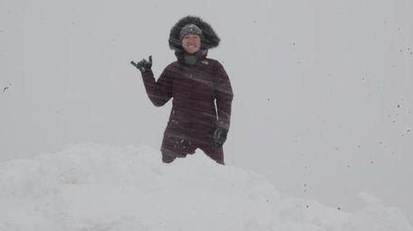 Kimberly Yuen poses atop a large mound of