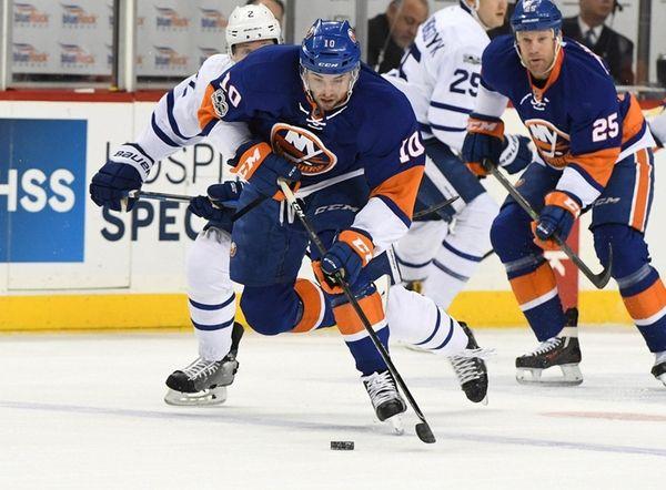 New York Islanders center Alan Quine skates with