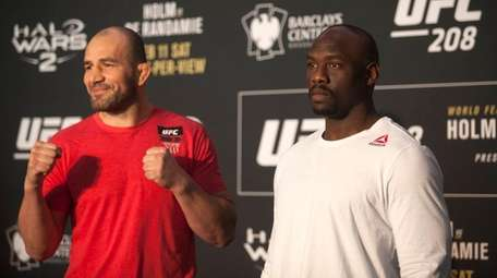 Glover Teixeira, left, and Jared Cannonier face off