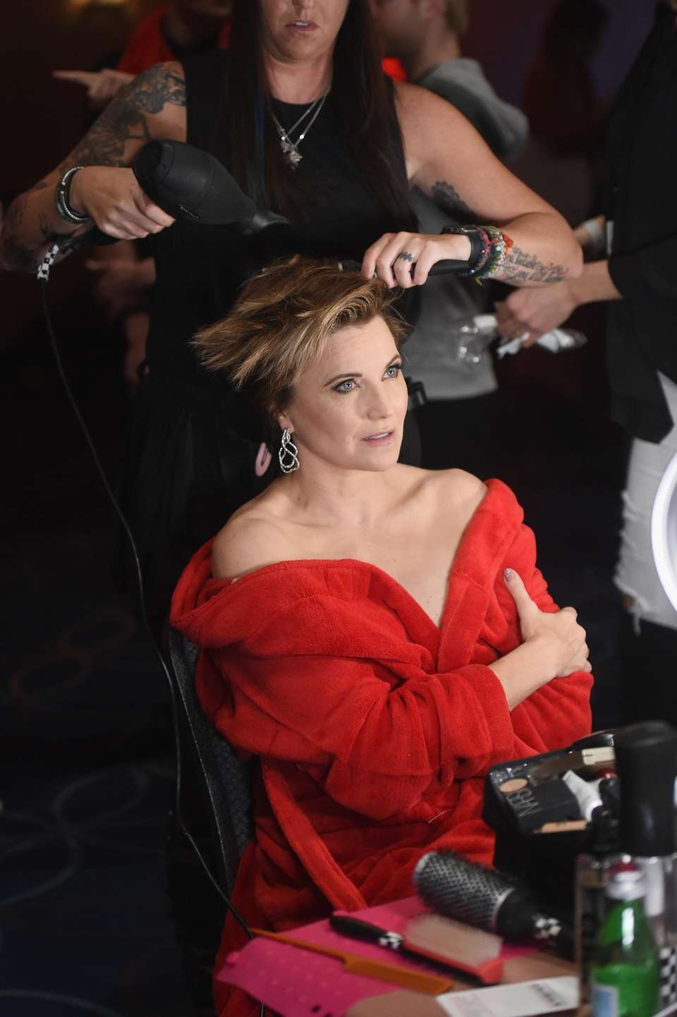Lucy Lawless prepares backstage at the American Heart