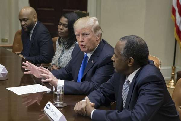 President Donald Trump holds an African American History