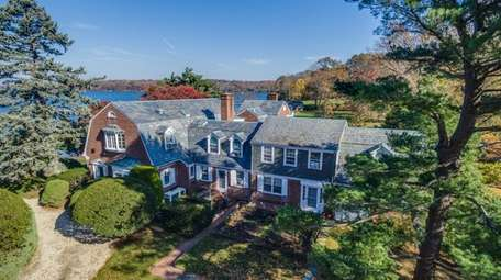 This circa 1950 brick home in Oyster Bay