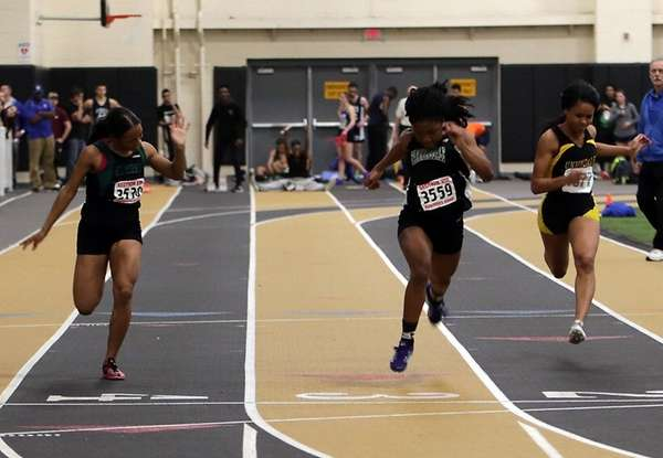 Farmingdale's Njaure Ewa finishes first in the 55-meter