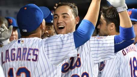 New York Mets rightfielder Michael Conforto is greeted