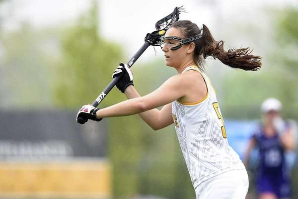 Adelphi attacker Jacqueline Jahelka (5) passes the ball