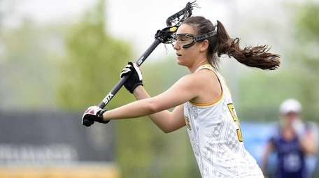 Adelphi attacker Jacqueline Jahelka (5) passes the ball
