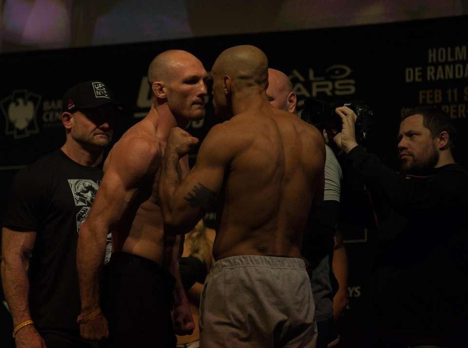 Ryan LaFlare, left, and Roan Carneiro face off