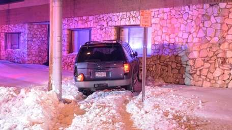 A damaged sport utility vehicle hit a wall