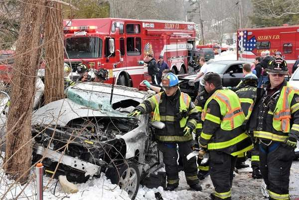 Selden firefighters respond to a car crash at