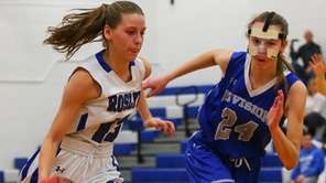 Samantha Busch of Roslyn drives to the basket