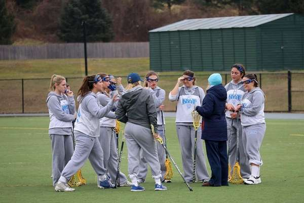 NYIT women's lacrosse players huddle during a practice