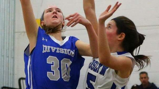 Division's Nora Tracey shoots as Roslyn's Emily Cohen
