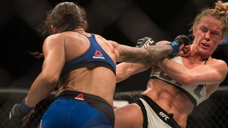 Women's featherweight Germaine de Randamie defeated Holly Holm